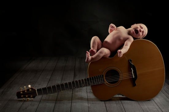 Baby on guitar